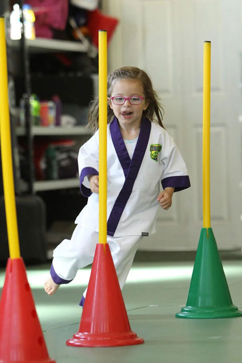 Lil Dragons Leeds student showing agility running in between cones