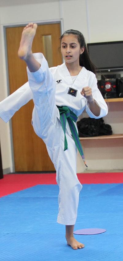 Junior Taekwondo Girl Kicking